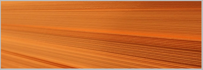 Image of a stack of orange paper stock