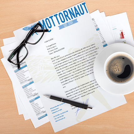 full color letterhead on desk coffee